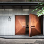 Geometrically Shaped Weathered Steel Doors Welcome Visitors To An Art Gallery In Taipei