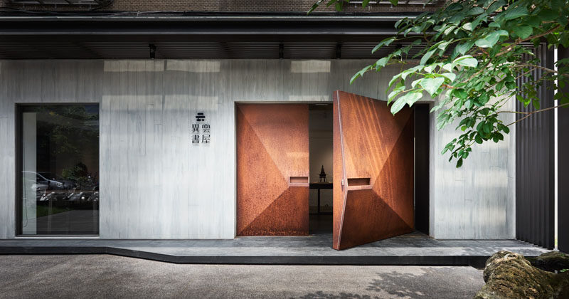 BASS Design have created the Yiyun Art Gallery, and as part of the design they installed geometrically shaped doors made from weathered steel. #WeatheredSteel #ModernDoor #SteelDoor