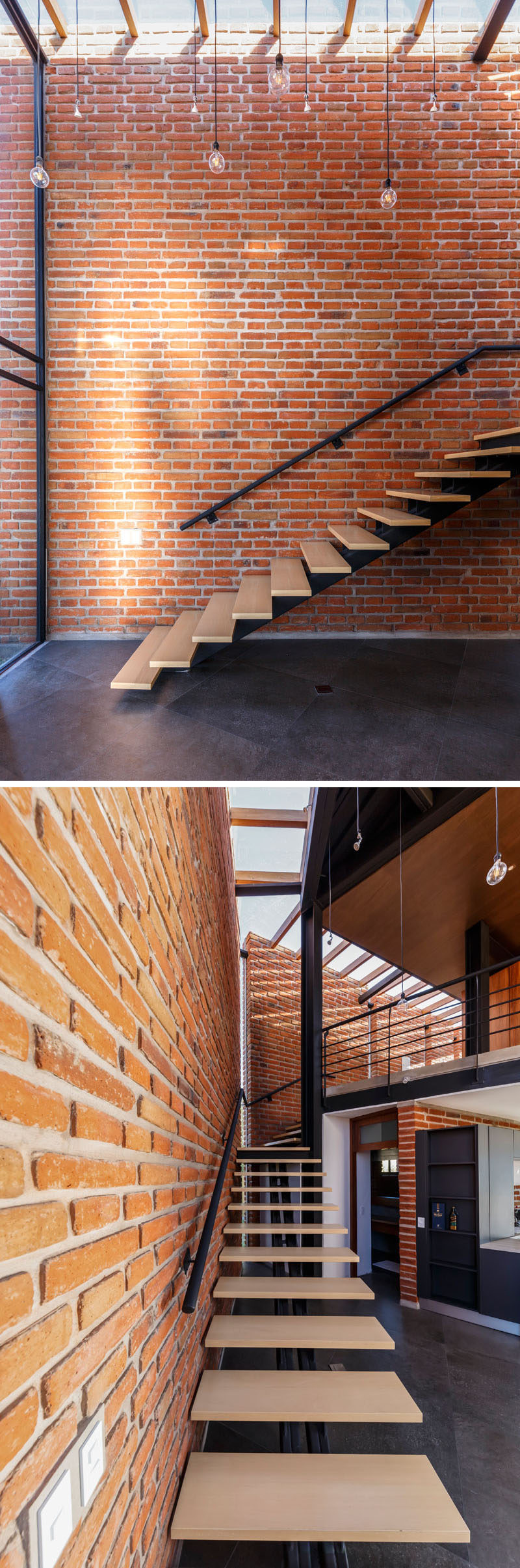 This modern house has wood stairs that run alongside a brick wall, while a skylight adds natural light to the space. #BrickWall #ModernStairs #Skylight