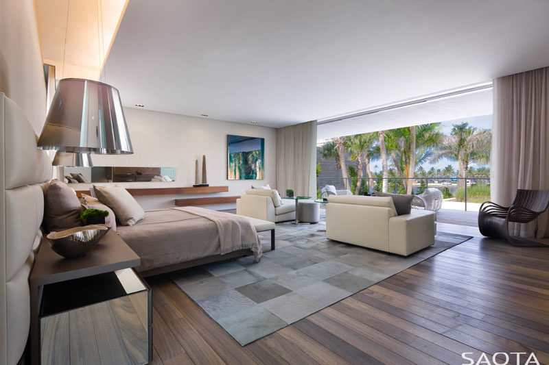 This large master bedroom suite enjoys the view from its own lounge area and balcony. #MasterBedroom