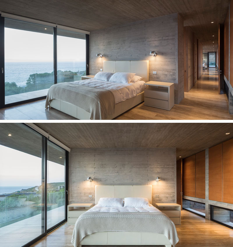A structural concrete wall becomes an accent wall behind the bed, and floor-to-ceiling windows and a glass door allow plenty of natural light to fill the bedroom. Click through to see more photos of this modern house. #ConcreteHouse #Bedroom #ConcreteAccentWall #SlidingGlassDoors
