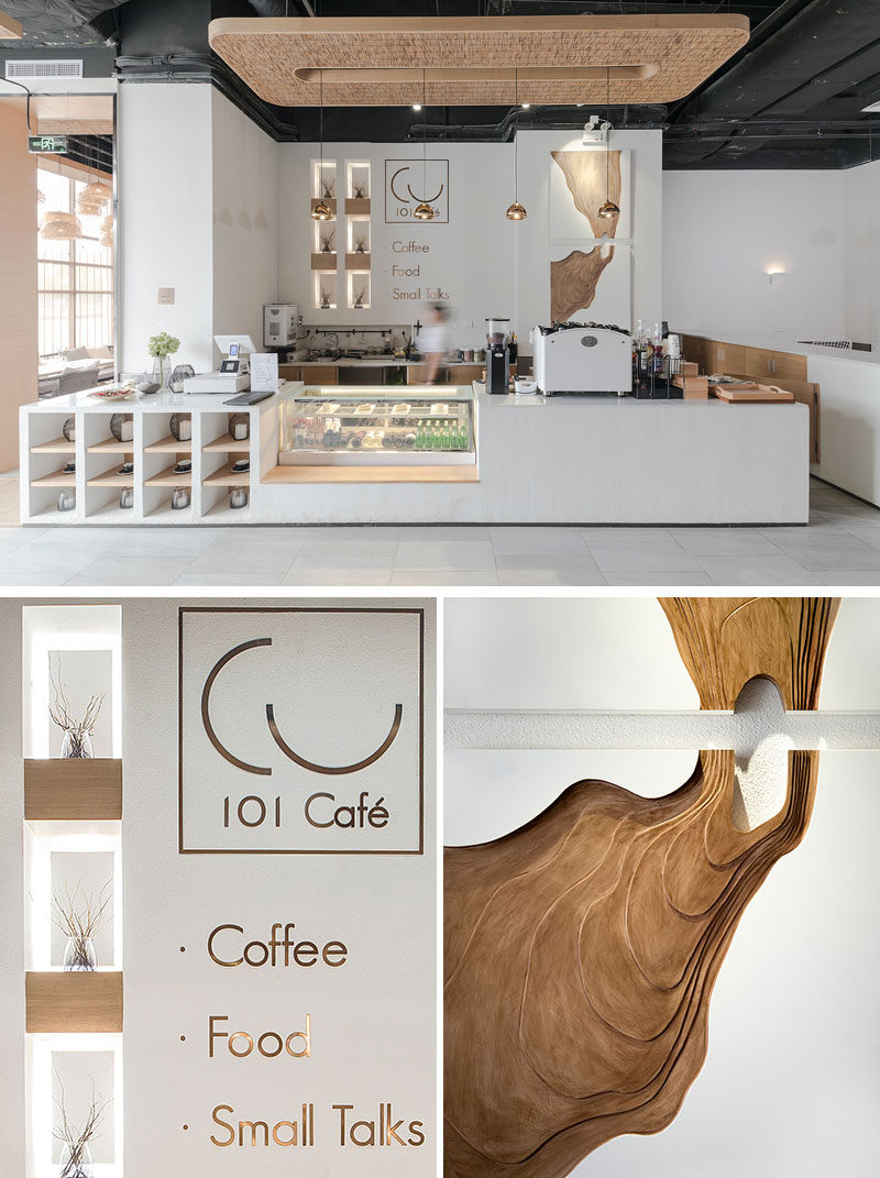 This modern coffee shop has a service area with open shelving, a cold case and a counter with the coffee maker. Back-lit display shelving brightens up a corner space, while artwork is highlighted with lighting. #ModernCoffeeShop #ModernCafe