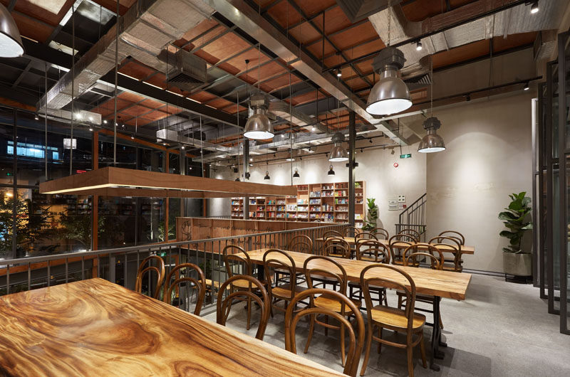 This modern coffee shop has a lofted area with communal tables, that can be used as a co-working space. #CoWorking #CoffeeShop #Cafe #CoffeeHouse