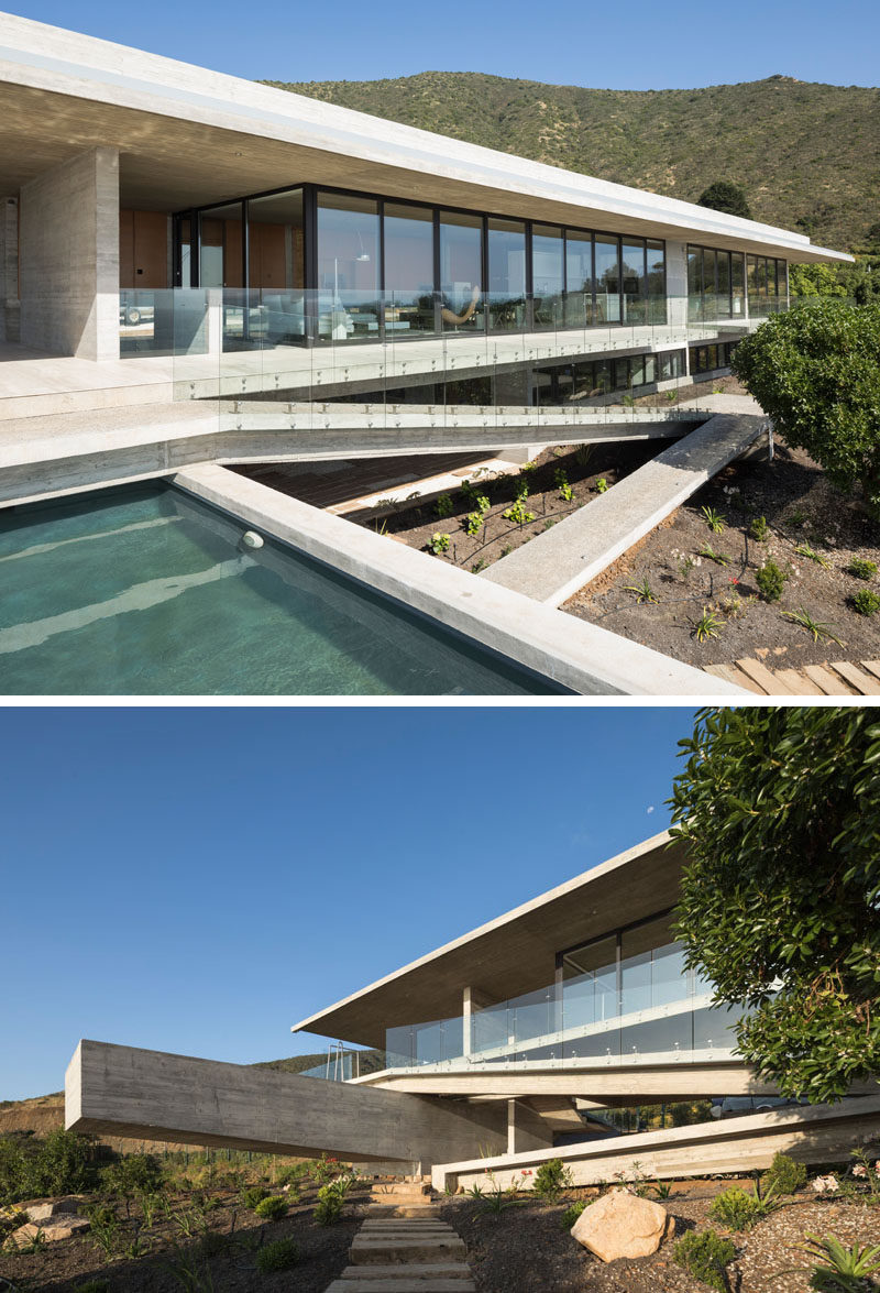 This modern concrete house has a cantilevered swimming pool and a sloped path that leads to the garden. Click through to see more photos of this house. #ConcreteHouse #ConcreteArchitecture #Path #SwimmingPool #Pool