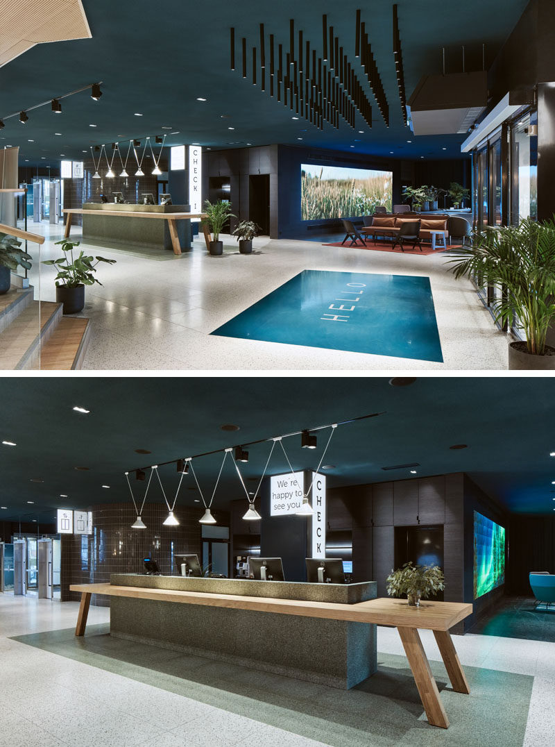 As guests enter this modern hotel in Finland, a large 'HELLO' welcomes them, before reaching the reception desk that resembles a large traditional Finnish wooden dining table. #ModernHotel #HotelReception #Lobby