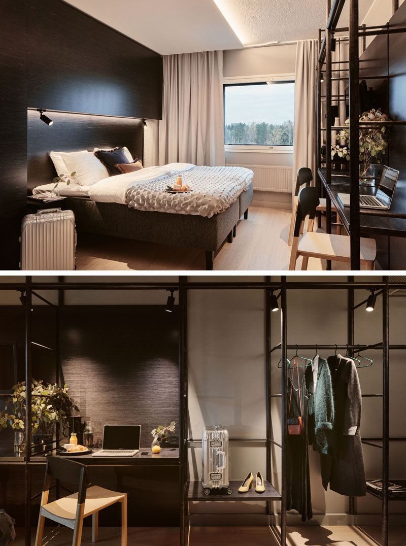 This modern hotel room has a dramatic look that's achieved with the use of dark wood. The built-in furniture is balanced by a open shelving unit with a desk and places to hang clothes. #HotelRoom #OpenShelving