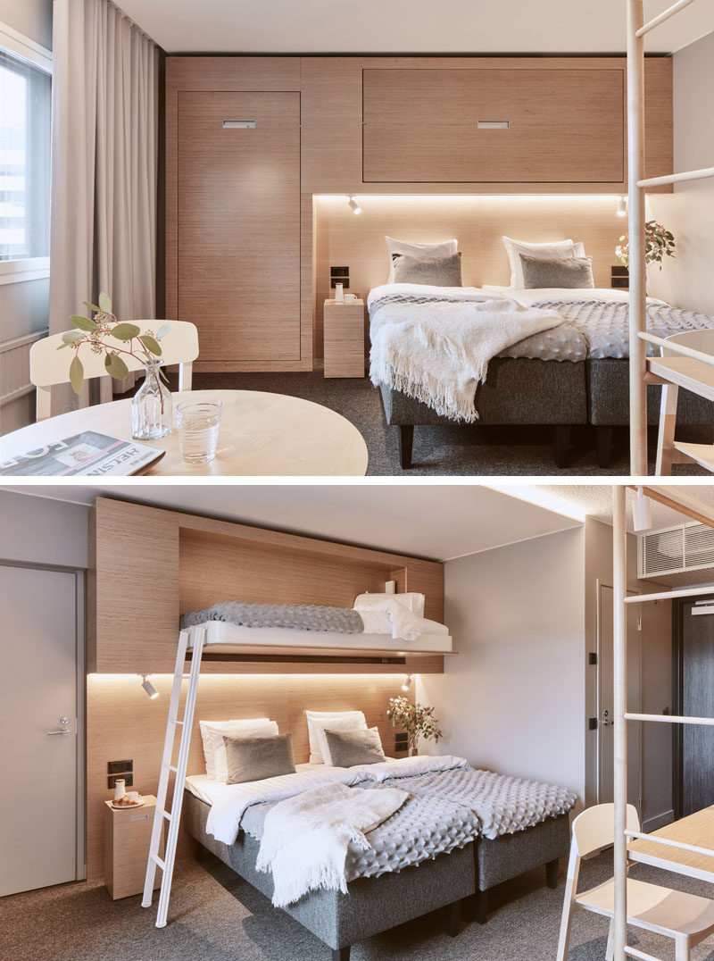 This modern hotel room has fold-down beds that almost blend into the wall and look like cabinets. #HotelRoom #FoldDownBed