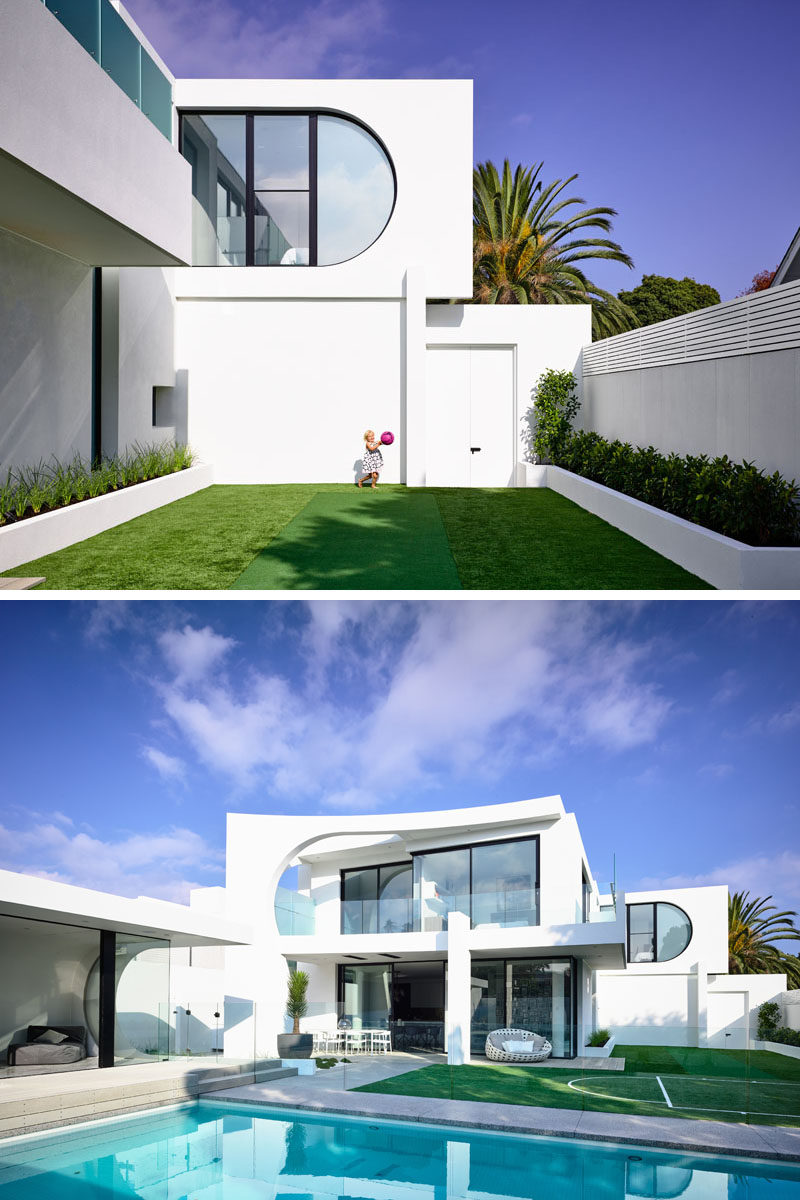 Off to the side of this house is a grassy area with a small cricket pitch and basketball/netball court. Click through to see more photos of this modern house. #Backyard #Landscaping #SwimmingPool #Architecture #ModernHouse