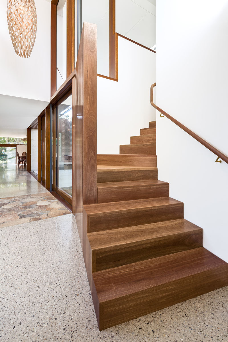 This modern house has wood stairs that lead to the master suite upstairs. Click through to see more photos of this Australian house. #ModernStairs #WoodStairs #Interiors