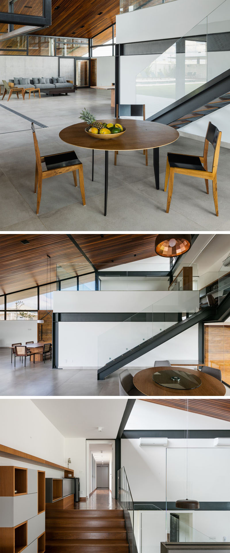 Metal and wood stairs lead to the second floor of this modern house. A glass handrail almost blends into the background. #ModernStairs #SteelStairs #GlassHandrail