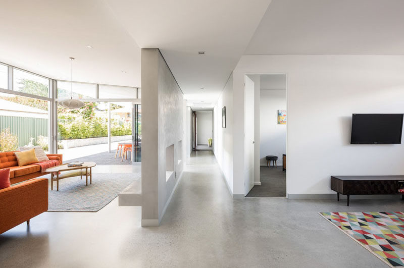 A central passage in this modern house acts as a simple access spine delineating and connecting the private and communal spaces. #Hallway #InteriorDesign