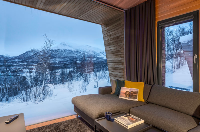 This modern living room has a large picture window that perfectly frames the view. #PictureWindow #LivingRoom