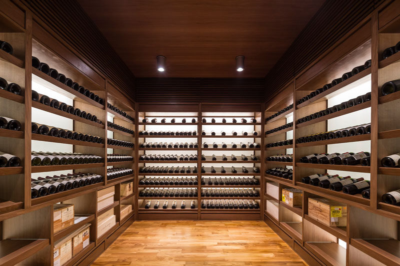 This walk-in wine cellar has plenty of black-lit shelving to nicely display the bottles. #WineCellar #WineStorage #Shelving