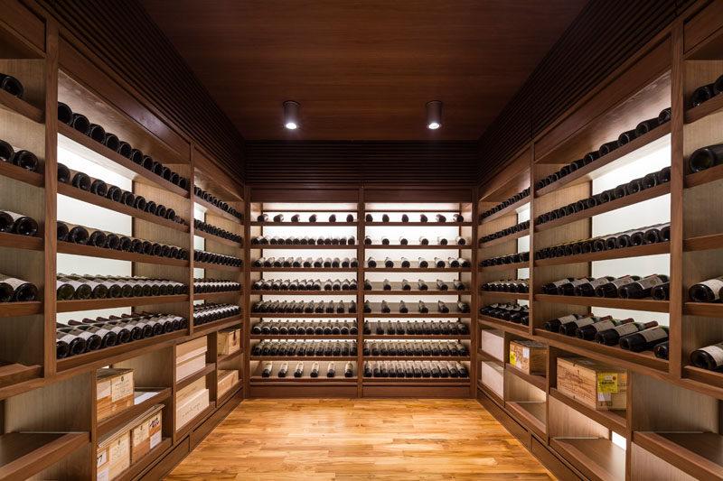 This walk-in wine cellar has plenty of black-lit shelving to nicely display the bottles. #WineCellar #WineStorage #Shelving