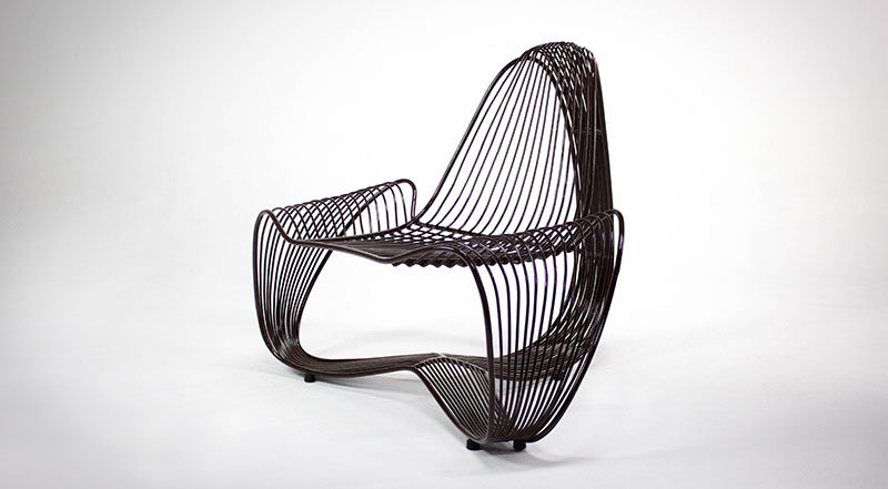 Ernesto Pastore has designed Conchita, a modern metal chair that was inspired by bivalve seashells and is made from stainless steel rods. #Design #Chair #Furniture
