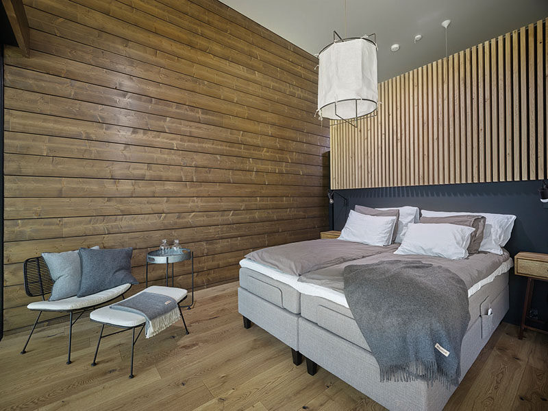 In this master bedroom, wood has been combined with neutral furnishings for a relaxed and contemporary look. #ModernBedroom #WoodWalls