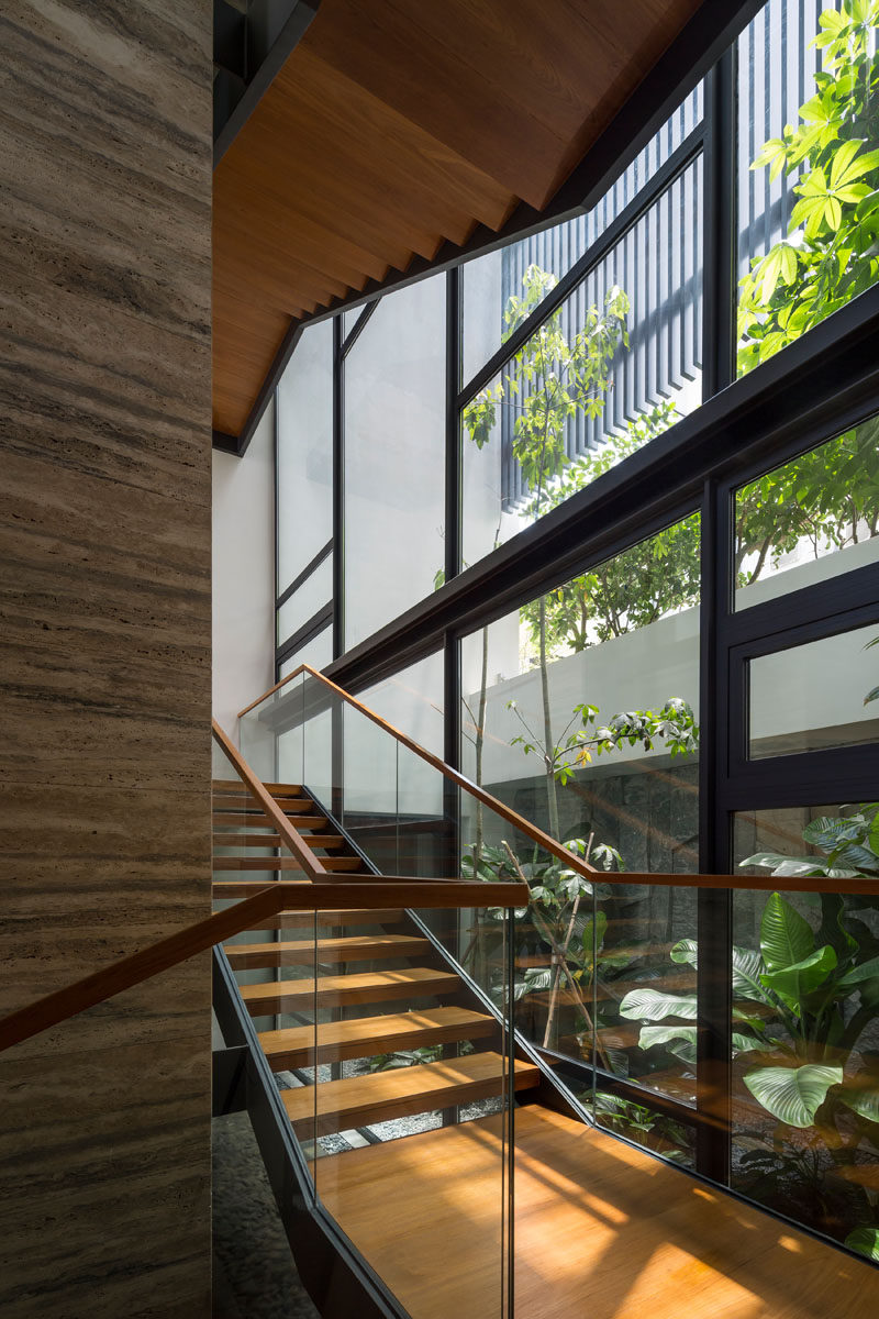 A wood and steel see-through staircase that connects the various levels of this modern house. #Stairs #WoodStairs #Windows