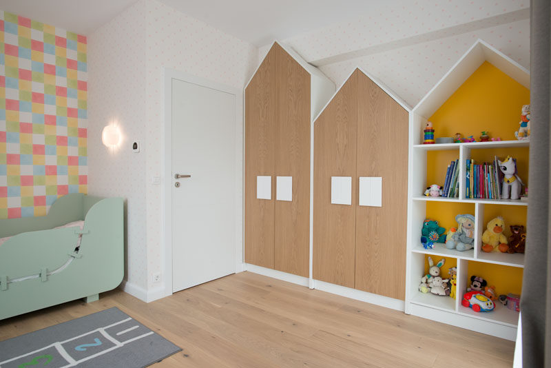 The handles on these house-shaped closet double as 'windows' and help to create a fun space for the child, but as they are larger than normal hardware found on cabinets, it also makes it easier for the child to open their closet. #Closets #Hardware #Cabinets #Handles