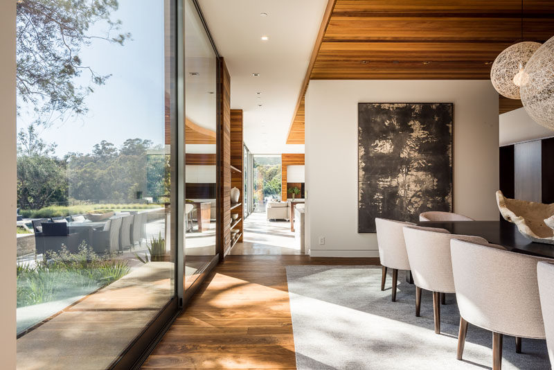 This contemporary dining room features Walnut flooring. #Flooring #WoodFlooring #DiningRoom