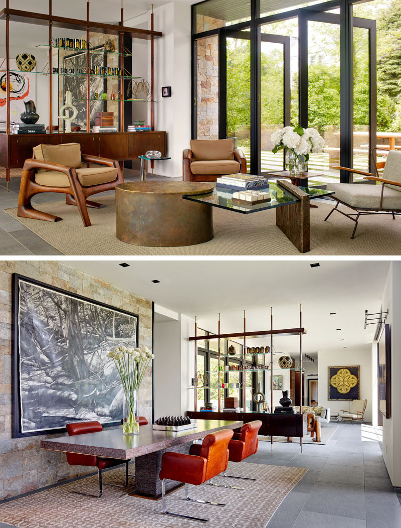 Stepping inside this contemporary house, there's the living room and the dining room, that are separated by a wood and glass room divider. #RoomDivider #LivingRoom #DiningRoom #InteriorDesign