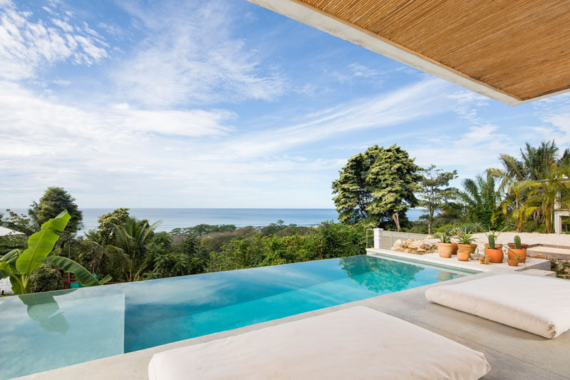 This modern Costa Rican hotel features an infinity pool that provides an unrestricted view of the trees and water in the distance. #InfinityPool #HotelPool #CostaRica