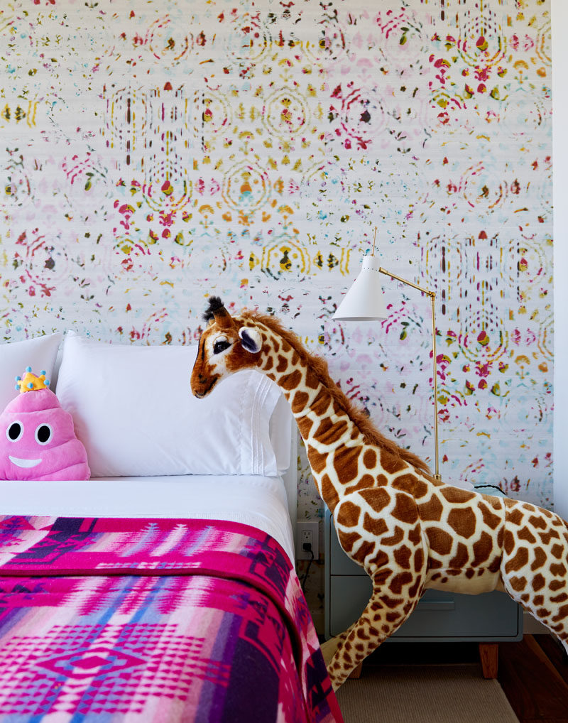 A colorful and patterned wall has been created behind the bed in this kids bedroom. #ModernBedroom #ColorfulBedroom