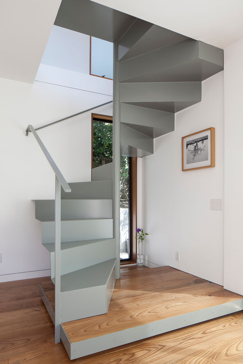 This minimalist grey steel staircase leads to the master bedroom upstairs. #Stairs #SpiralStairs #MetalStairs #ModernStairs