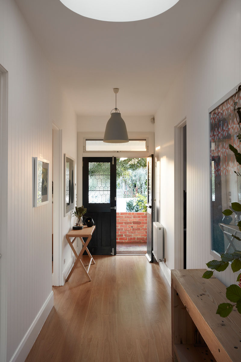 To retain the original characteristics of this old Australian house, rotting floorboards were replaced with new boards, giving the home a fresh update. #WoodFlooring #Skylight #Hallway #InteriorDesign