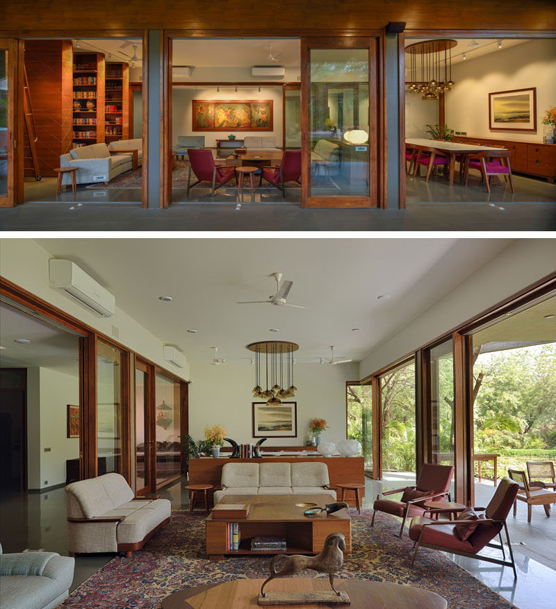 Sliding wood-framed glass doors open the interior of this contemporary house to the patio and create an indoor/outdoor living environment. #IndoorOutdoor #Doors #LivingRoom