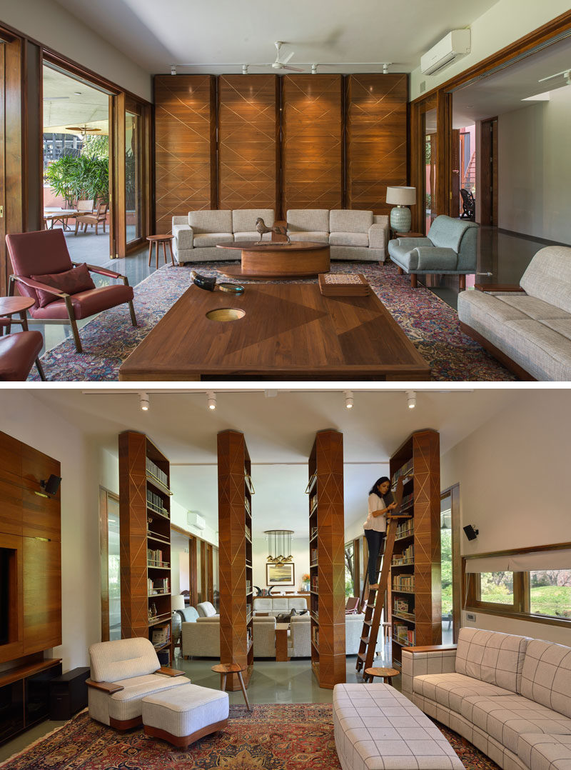 Separating the social areas of this contemporary house are four floor-to-ceiling panels, that when rotated reveal hidden bookshelves and an opening to a secondary living room. #Library #Shelving #Bookshelves #LivingRoom