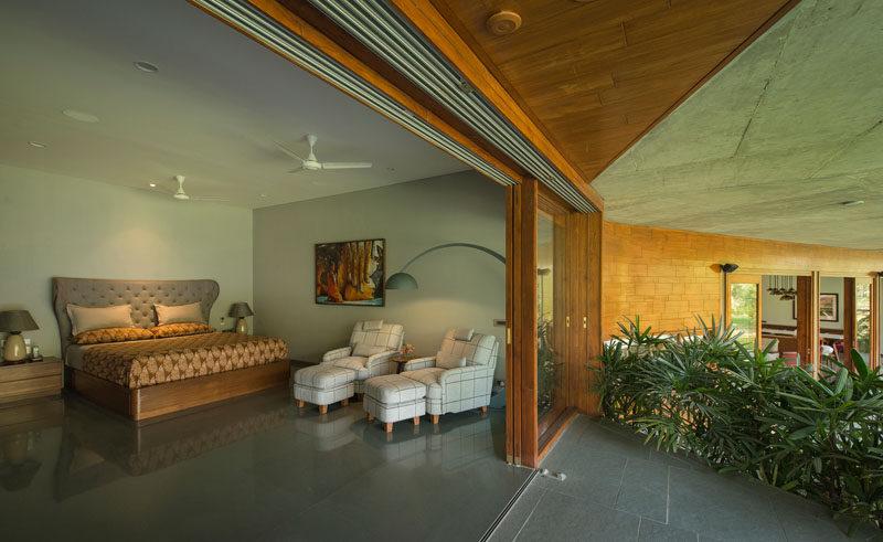 Sliding glass doors open this bedroom to a private patio. #SlidingGlassDoors #Bedroom