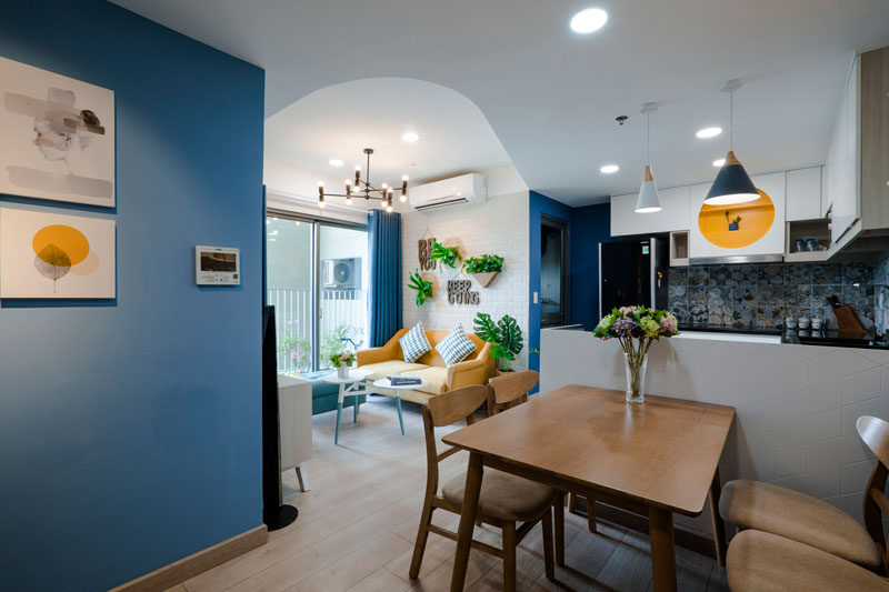Design studio TOKI HOME  have completed a cozy apartment in Vietnam for a mother and her 5-year-old son, who wanted a cheerful space that would be welcoming. Click through to see more photos of this contemporary apartment. #InteriorDesign #BlueAndYellow