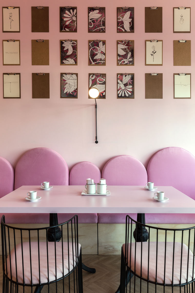 This modern patisserie has several clipboards where customers can draw or write whatever they want in these 'blank screens', which are then placed on display. #ModernCafe #Patisserie #InteriorDesign #Art #Pink