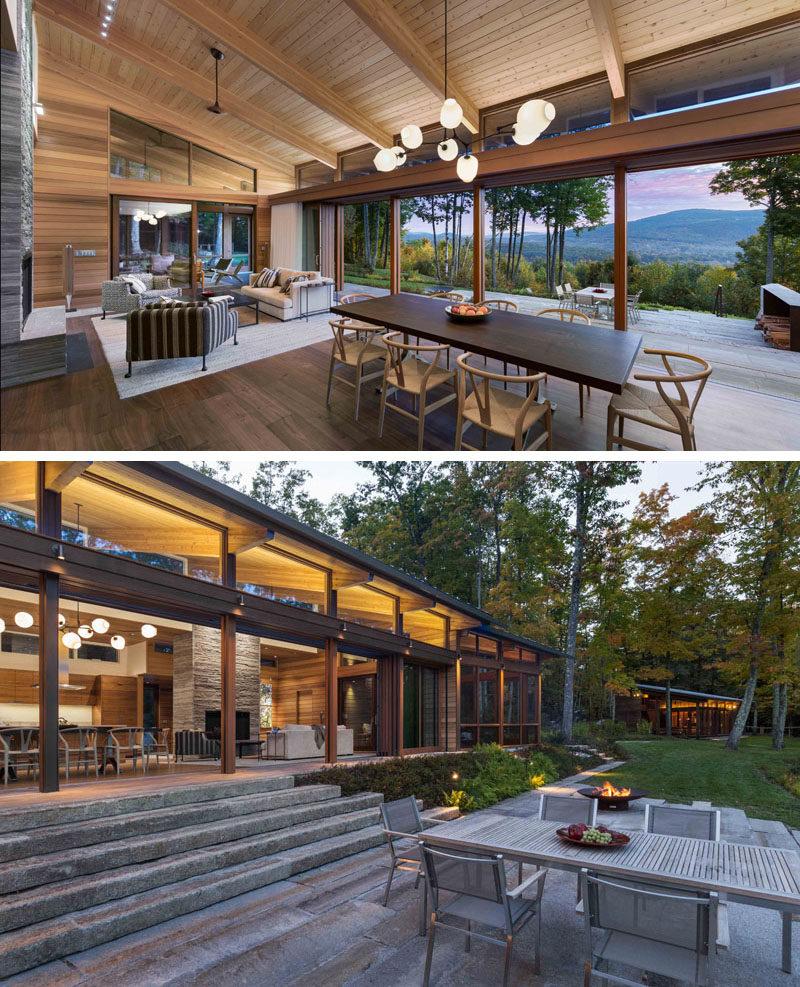 A40-foot retractable glass door system opens up to create a true indoor / outdoor living environment for this modern house. #RetractableGlassDoors #IndoorOutdoor #ModernHouse