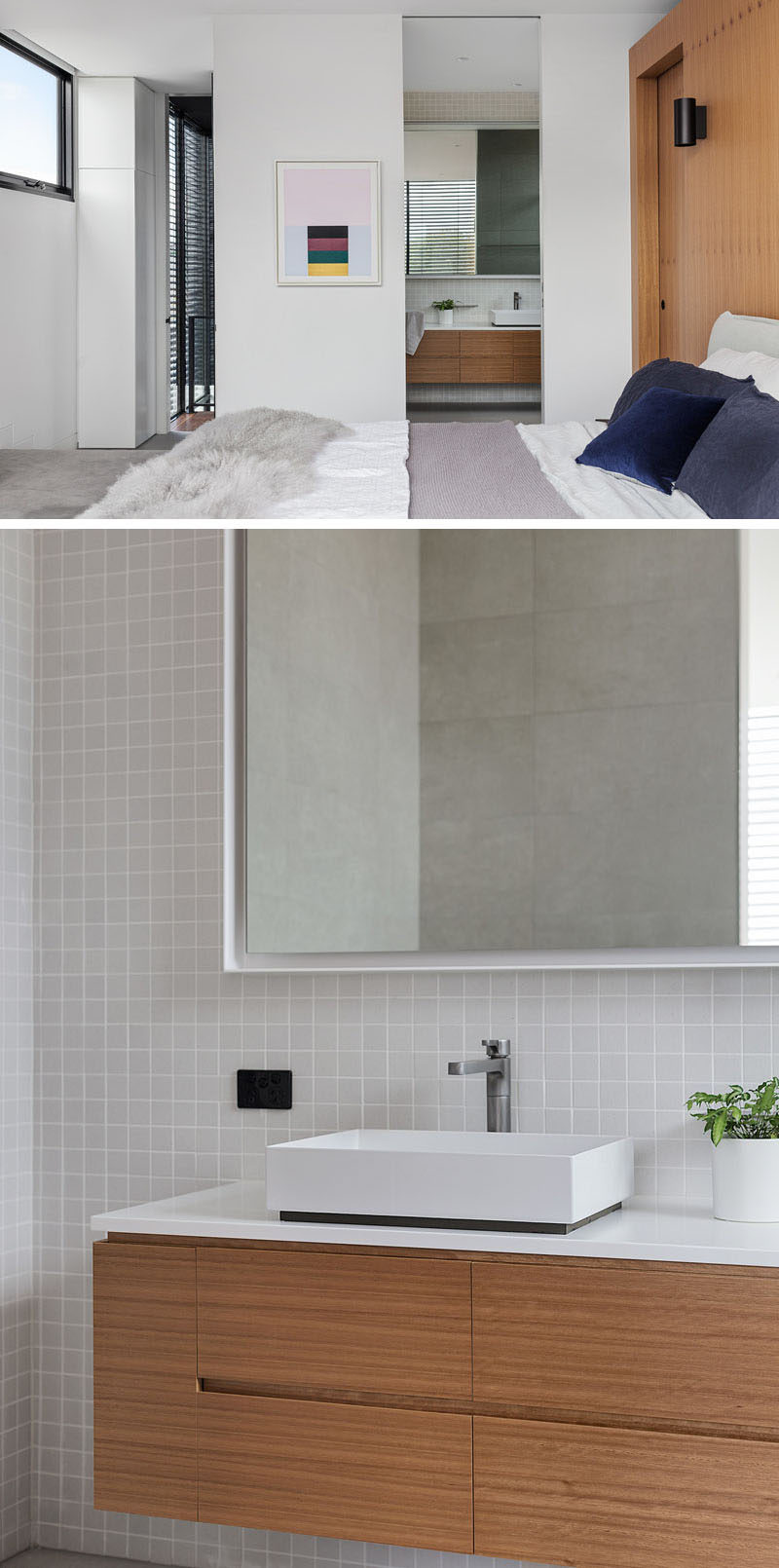 A wood vanity in this modern bathroom is topped with a white counter and basin, while light colored square tiles cover the walls. #ModernBathroom #BathroomDesign