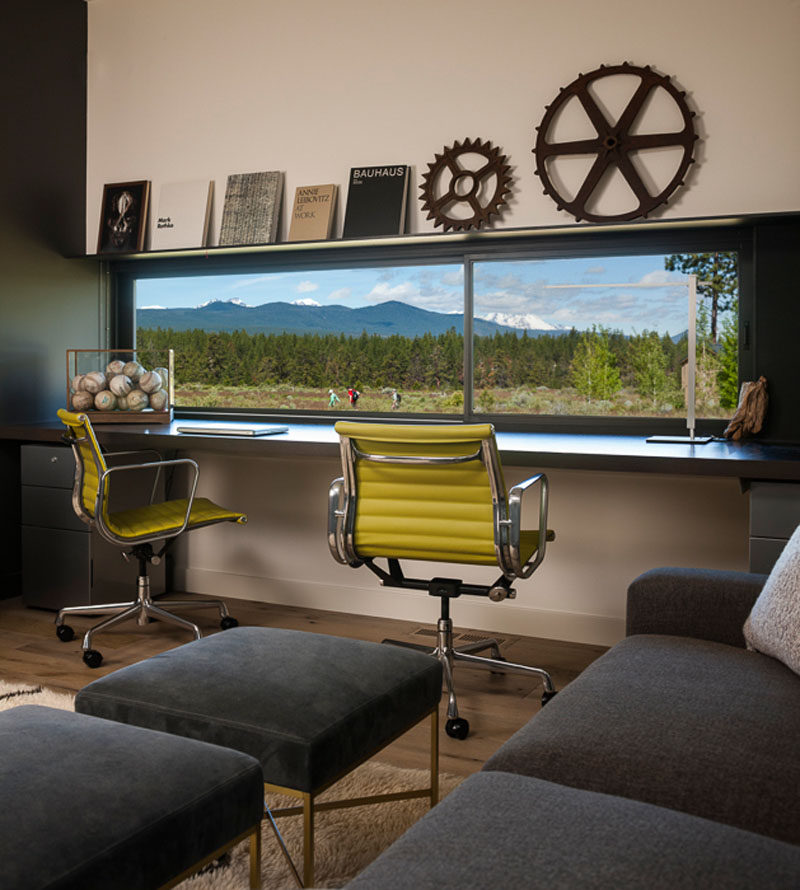This modern home office has a window that perfectly frames the view. #HomeOffice #Window #InteriorDesign