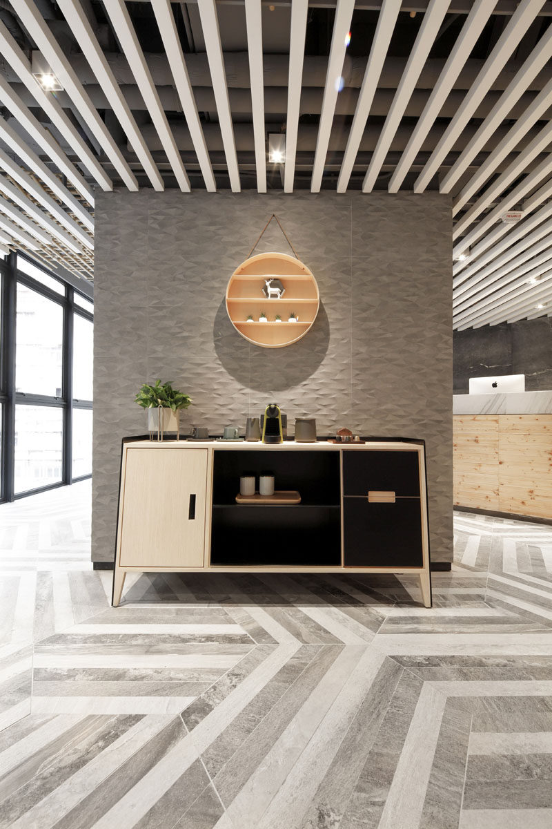 Simple furnishings have been used throughout this modern hotel, like in the lobby, where a simple sideboard has been used as a tea and coffee station. #InteriorDesign #Sideboard #HotelDesign