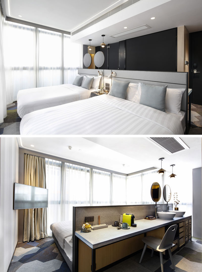 This modern hotel room, suitable for four people, has a headboard that also doubles as a desk and bathroom vanity. #ModernHotel #HotelRoom #Headboard #Bedroom