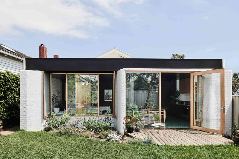 Taylor Knights Architecture & Interior Design have given a Californian bungalow home in Victoria, Australia, a new and modern 538 square foot (50sqm) addition that houses a living room, dining area and kitchen. #Architecture #HouseExtension #HouseAddition