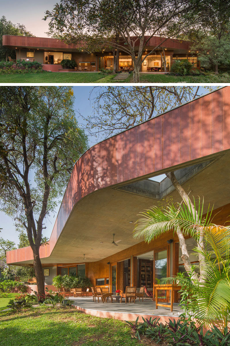 Modo Designs have recently completed a contemporary house on the outskirts of Ahmedabad, India, that has a curved layout to take advantage of the views of a lily pond and the surrounding landscaping. #Architecture #HouseDesign #CurvedArchitecture