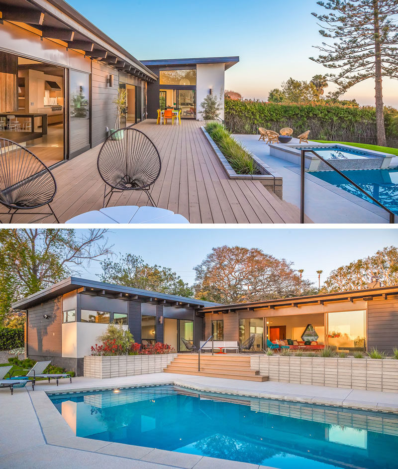 To create a true indoor / outdoor living environment, there's awrap-around deck on this house that leads to various seating areas, the swimming pool and the backyard. #Deck #Landscaping #SwimmingPool