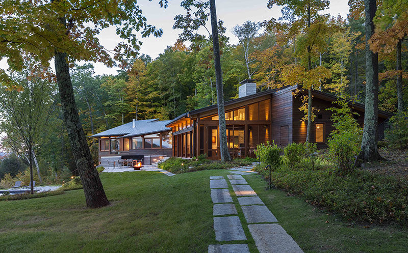 Mathison | Mathison Architects have designed a new modern wood house for a family that sits high above the Housatonic River in Great Barrington, Massachusetts. Click through to see more photos. #ModernArchitecture #HouseDesign #Landscaping