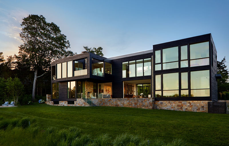 Blaze Makoid Architecture have designed a new house on Sag Harbor in North Haven, New York, for a family that love to entertain year round. #ModernHouse #BlackWood #Stone #Architecture