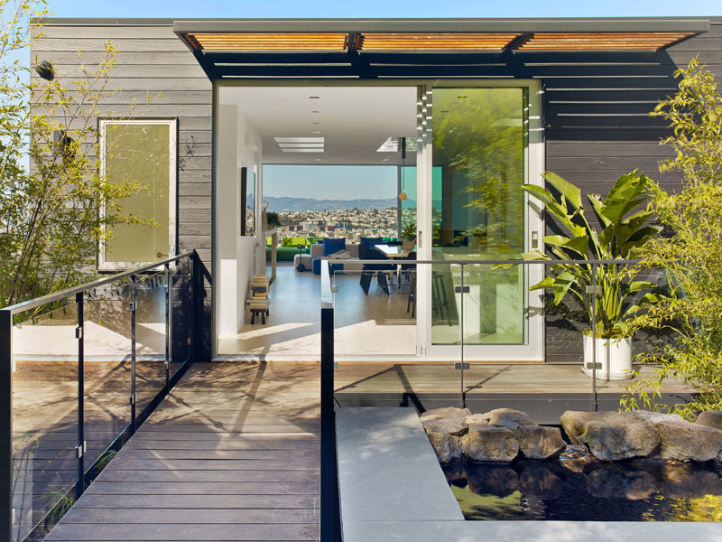 This modern house has a small bridge area that leads from the interior to the backyard. #Architecture #Landscaping