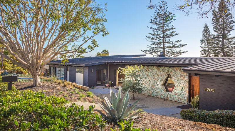 This renovated mid-century home in California has a turquoise stone accent wall and a custom designed window. #Architecture #Stone #Window