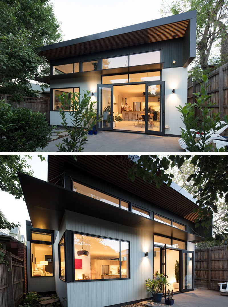 This new house extension that folding doors that open up to a small patio area, creating more living space. #HouseExtension #Architecture