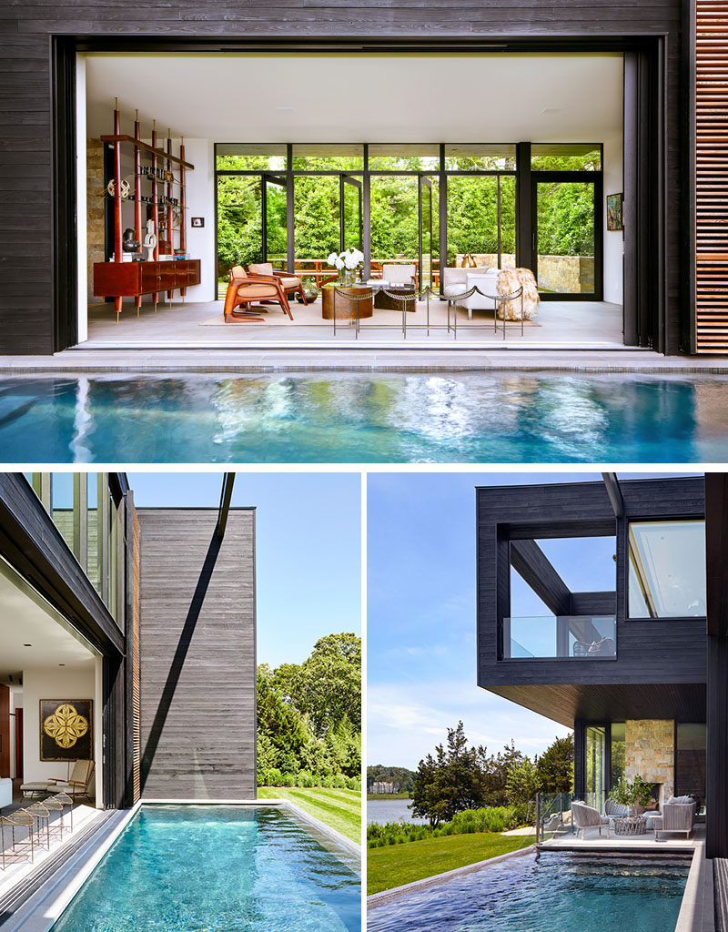 Floor to ceiling, wall to wall glass panels open the center of this modern house to the outdoors, creating a true indoor/outdoor living environment. On one side of the living room is the front patio, and on the other is the swimming pool. #ModernHouse #SwimmingPool #LivingRoom #GlassWalls