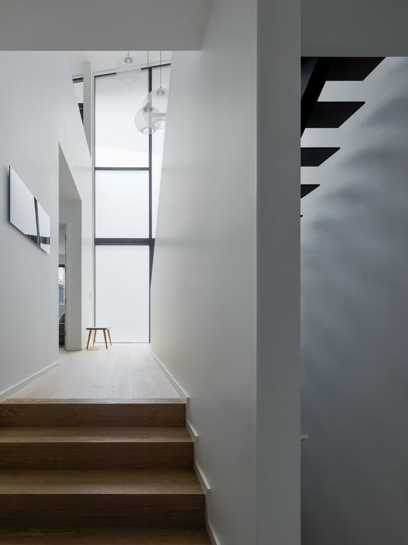 This modern house has both wood stairs and black painted steel stairs. #ModernHouse #FrostedWindows #WoodStairs #BlackStairs