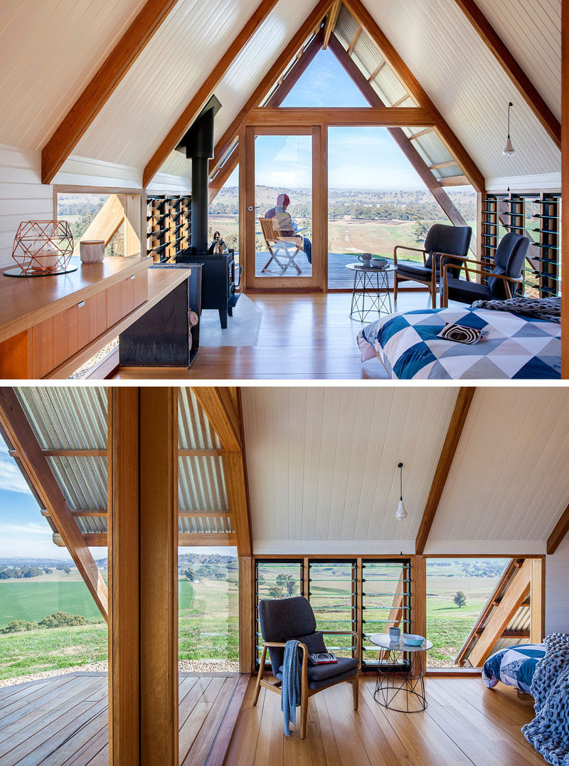 The windows follow the structural lines of this small and contemporary cabin, and there's a small living area with a door that opens to a deck with views of the valley. #Cabin #Hut #InteriorDesign #Windows