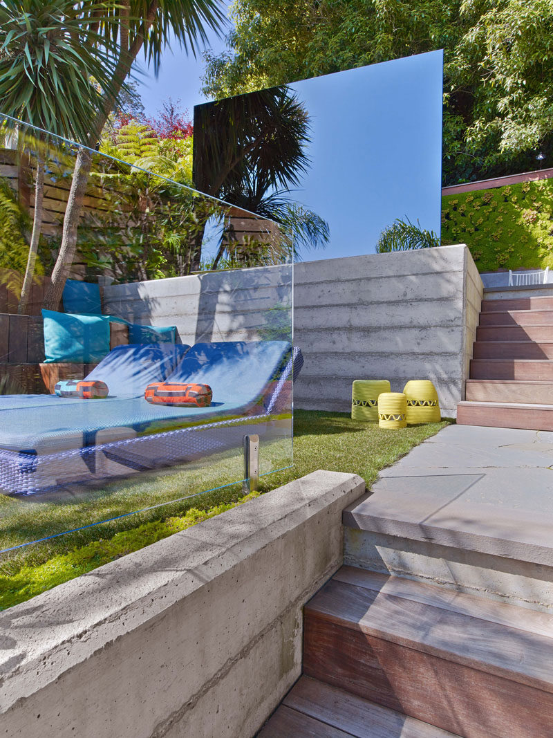 This modern backyard has a mirrored box that hides a private seating area within, designed for brainstorming and stargazing. #Landscaping #Architecture